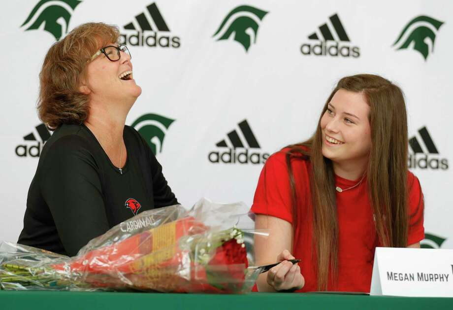 Megan Murphy, right, shares a laugh with her mother, Lisa, after signing to swim for the University of the Incarnate Word during an athletic signing ceremony at The Woodlands Christian Academy, Wednesday, May 13, 2020, in The Woodlands. Photo: Jason Fochtman, Houston Chronicle / Staff Photographer / 2020 © Houston Chronicle