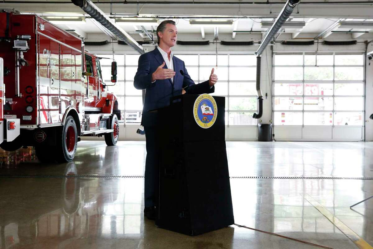 Gov. Gavin Newsom discusses his revised state budget proposal during a news conference at the CalFire/Cameron Park Fire Station in Cameron Park, Calif., Wednesday, May 13, 2020.