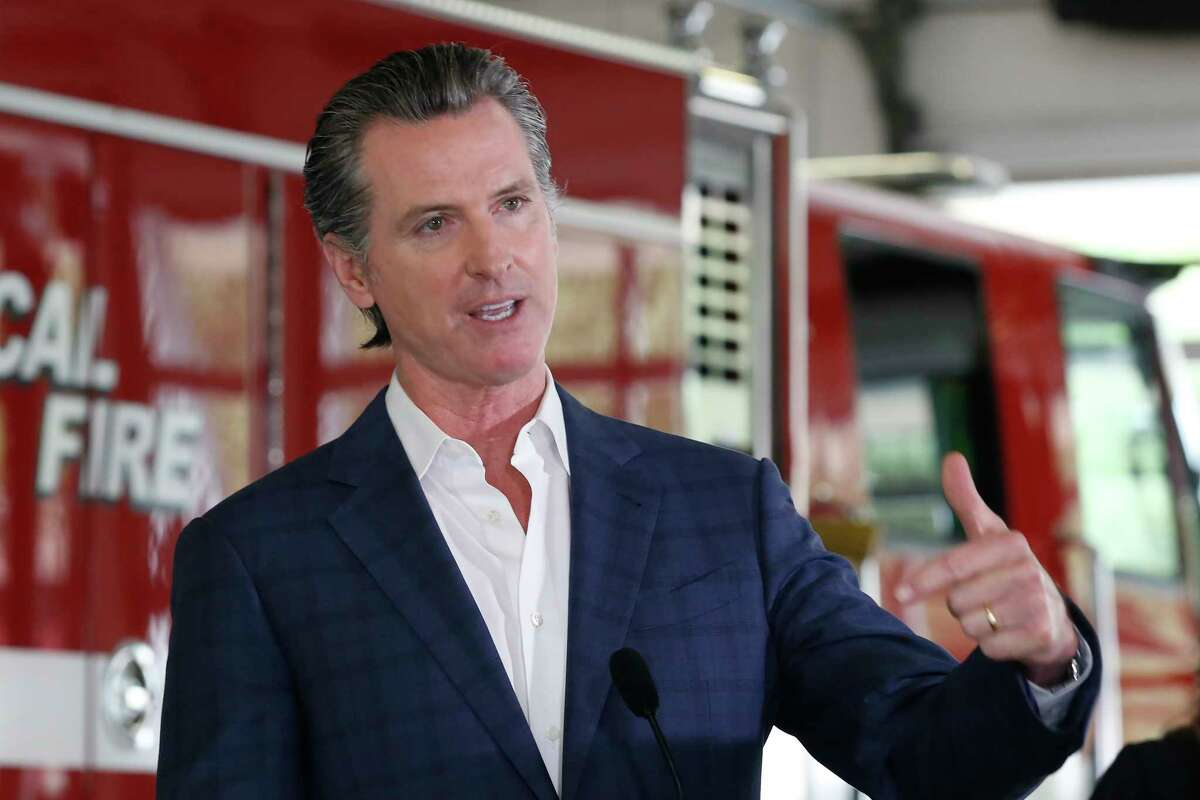 Gov. Gavin Newsom discusses his revised state budget proposal during a news conference at the CalFire/Cameron Park Fire Station in Cameron Park, May 13, 2020.