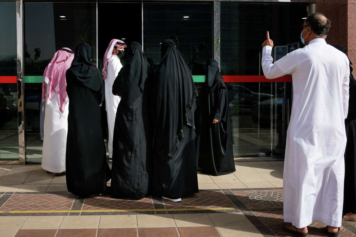 A queue forms outside the entrance to a mall in Riyadh., Saudi Arabia.