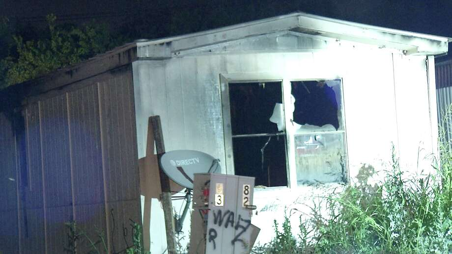 The Bexar County Fire Marshal is investigating the cause of a fire that completely destroyed an abandoned trailer Wednesday night. Photo: Ken Branca