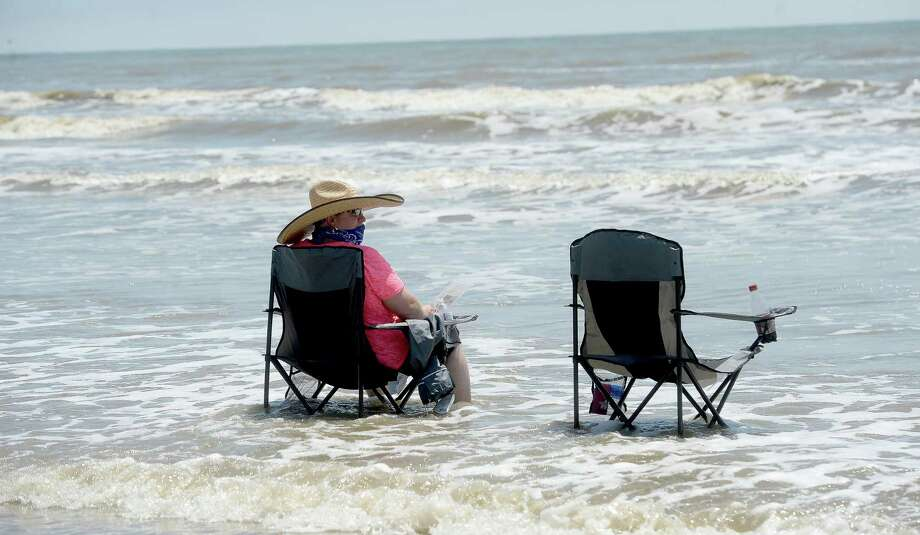 Relaxing in the surf at Sea Rim State Park. Click through this slide show to see parks within driving distance of Beaumont. Photo: Kim Brent / Kim Brent/The Enterprise / BEN