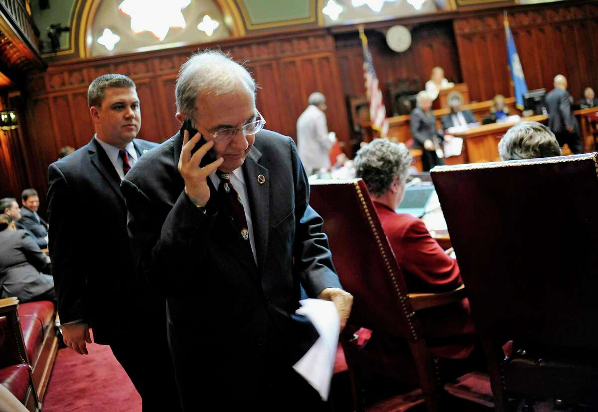 Connecticut State Senate President Martin Looney takes a phone call in Senate Chambers at the Capitol on the final day of session, Wednesday, June 3, 2015, in Hartford, Conn.