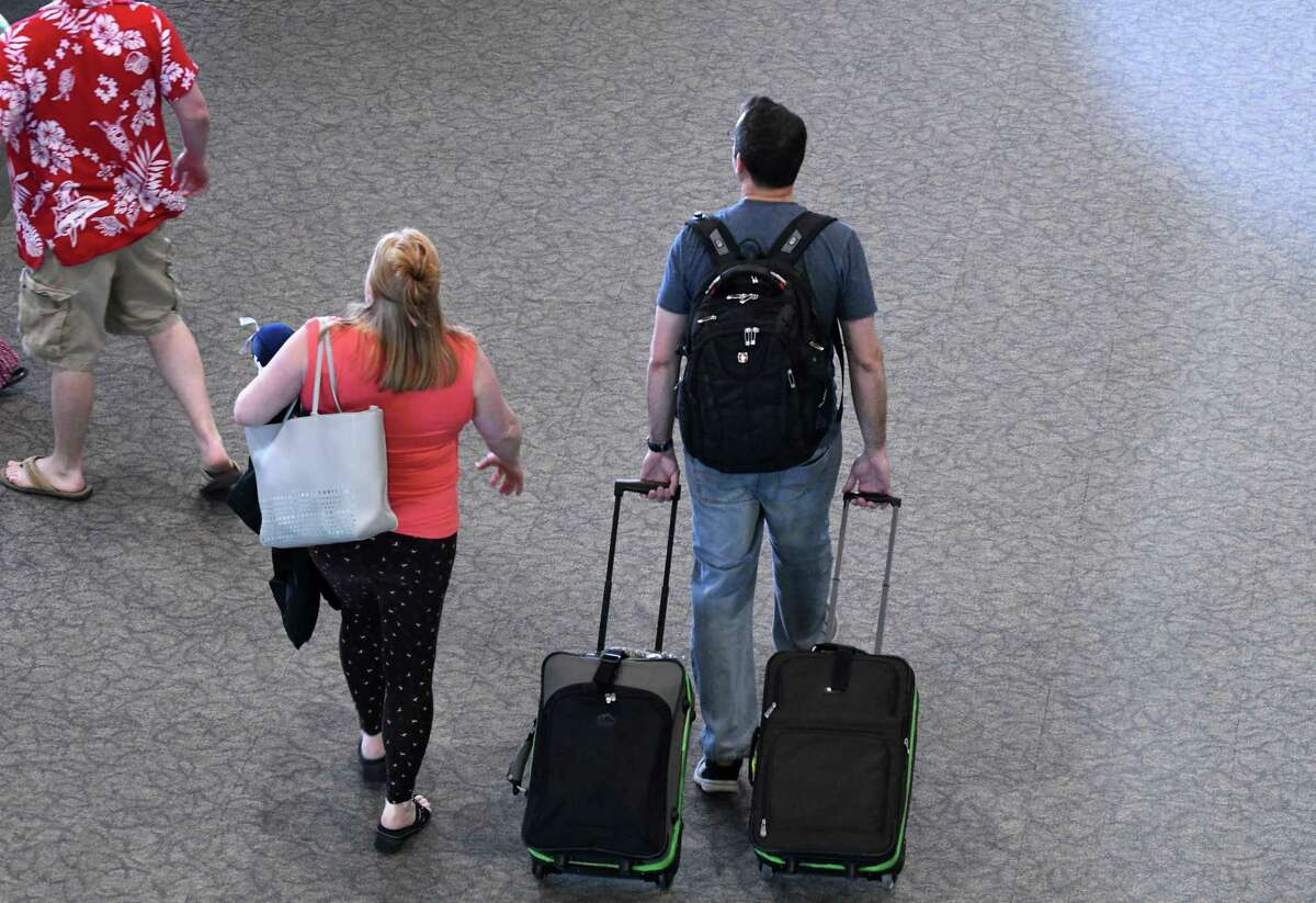 Travelers make their way through Albany International Airport ahead of the Memorial Day weekend on Wednesday, May 22, 2019, in Colonie, N.Y. (Will Waldron/Times Union)