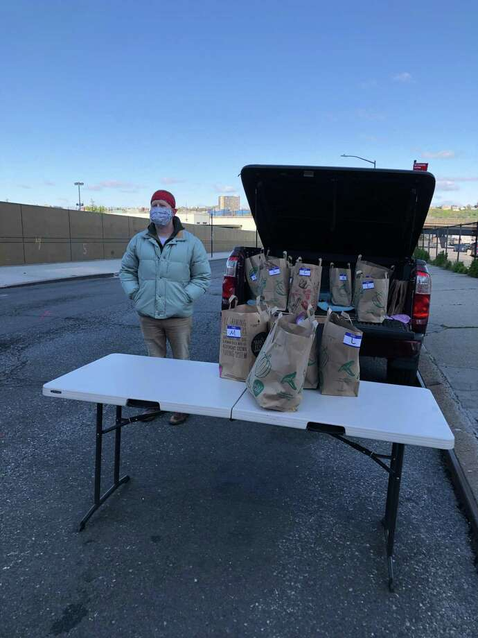 Darien resident Ben Geeding giving out bags of items to the homeless in Manhattan. Photo: Contributed Photo / Connecticut Post