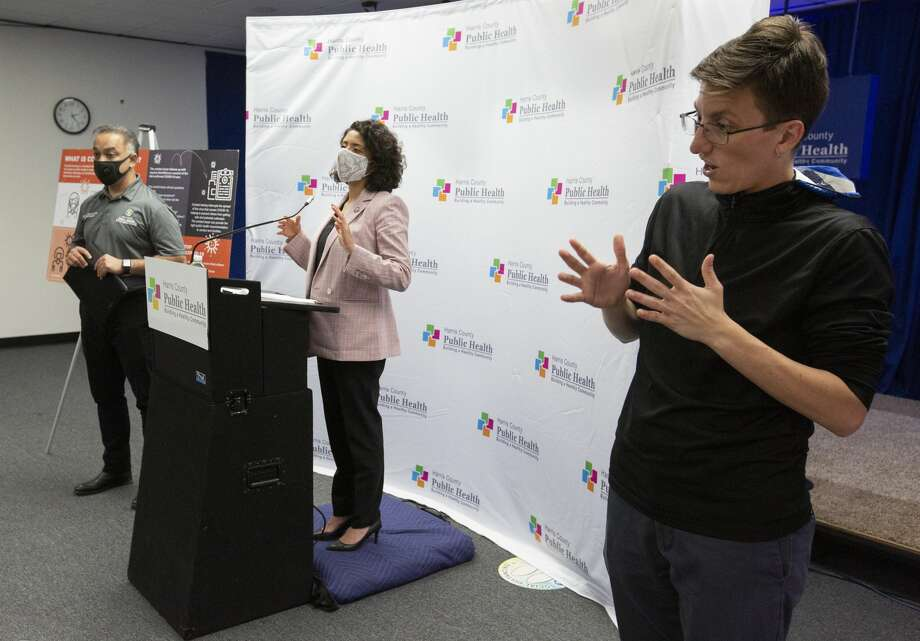 Harris County's stay-home, work-safe order is expected to beextended through June 10. ASL Interpreter Kala Winkelmann, from right, interprets sign language for Harris County Judge Lina Hidalgo and Harris County Public Health Department Executive Director and Dr. Umair Shah during a press conference regarding to the contact tracer army Wednesday, May 13, 2020, at Harris County Public Health Department in Houston. The HCPHD currently has about 50 contact tracers and the agency is aiming to have 200 by the end of the week, and have 300 contact tracers next week. Photo: Yi-Chin Lee/Staff Photographer / © 2020 Houston Chronicle