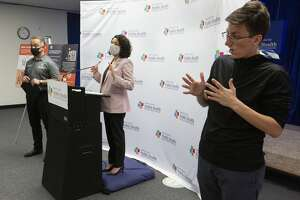 ASL Interpreter Kala Winkelmann, from right, interprets sign language for Harris County Judge Lina Hidalgo and Harris County Public Health Department Executive Director and Dr. Umair Shah during a press conference regarding to the contact tracer army Wednesday, May 13, 2020, at Harris County Public Health Department in Houston. The HCPHD currently has about 50 contact tracers and the agency is aiming to have 200 by the end of the week, and have 300 contact tracers next week.