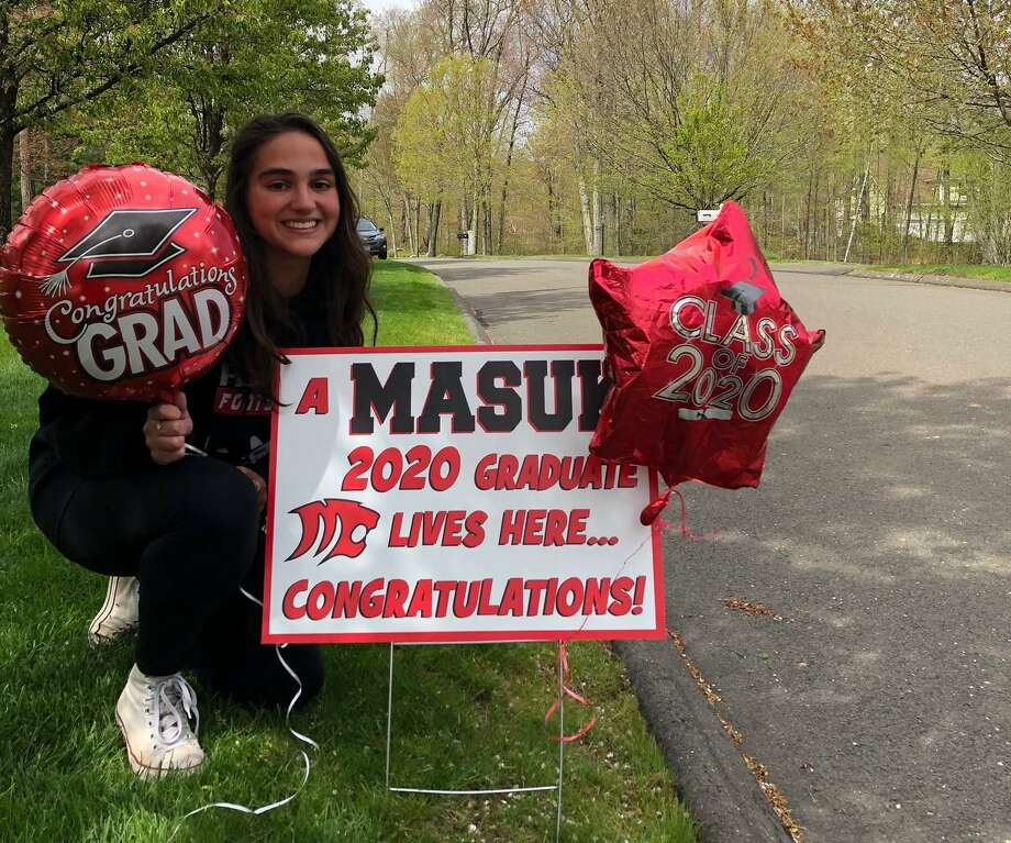 Emma Michetti was all smiles after receiving her graduation sign Saturday, May 9. Photo: Contributed Photo / Connecticut Post