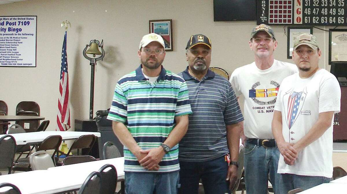 Veterans Nicholas Webster, left, Lewis Barnes, Warren Doyle and Raul Moreno hope a fundraising effort can save VFW Post 7109 in Pearland.