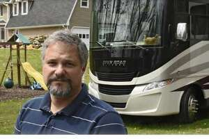 Roy Jacobsen stands in front of his RV which is parked in a relative's yard on Friday, May 8, 2020 in Valatie, N.Y. Roy and his wife Marrisa live in the RV full-time and drove it up from their winter spot in Naples, FL. They're waiting for the RV park in Rensselaer County to open up which is closed due to the Coronavirus pandemic.
