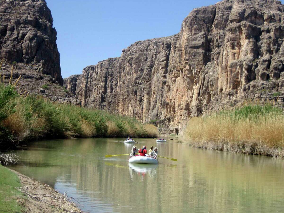 Rafts piloted by guides emerge from Heath Canyon, carved by the Rio Grande through Big Bend National Park in this 2011 photo.