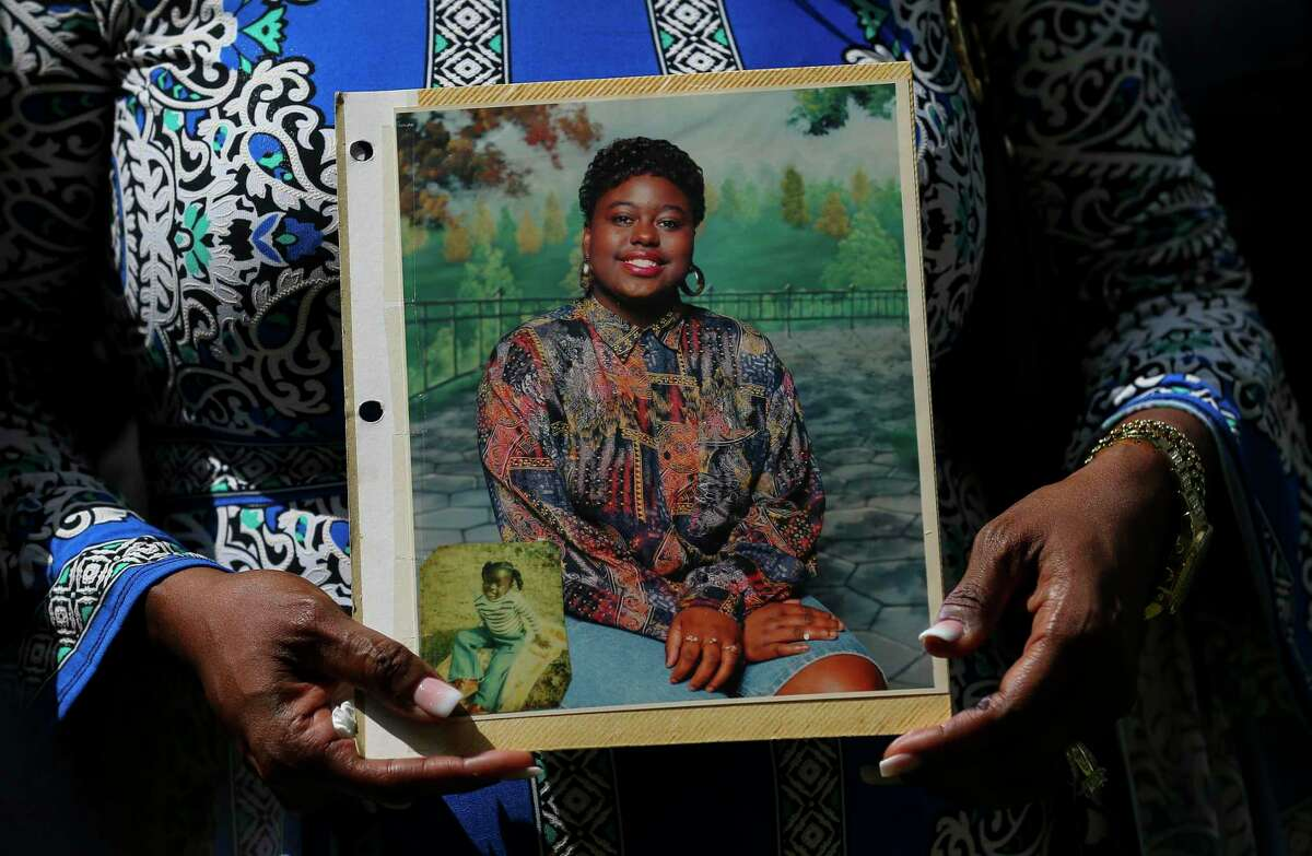Antoinette Dorsey-James holds a picture of her sister Pamela Turner during a press conference outside the Harris County Civil Court Thursday, May 16, 2019, in Houston. Turner was killed during an altercation with a Baytown Police Department officer Monday night at The Brixton Apartments complex she lived at in Baytown, Texas.