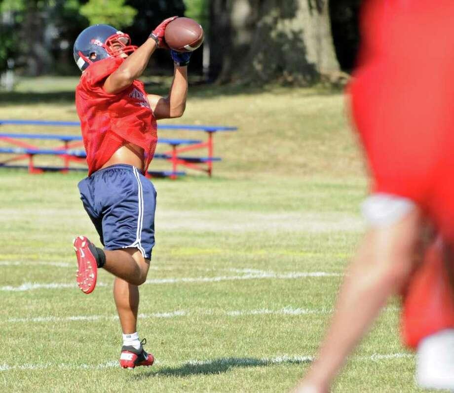 Mister Taylor catches a pass during football practice at Schenectady High.  (Lori Van Buren / Times Union) Photo: Lori Van Buren
