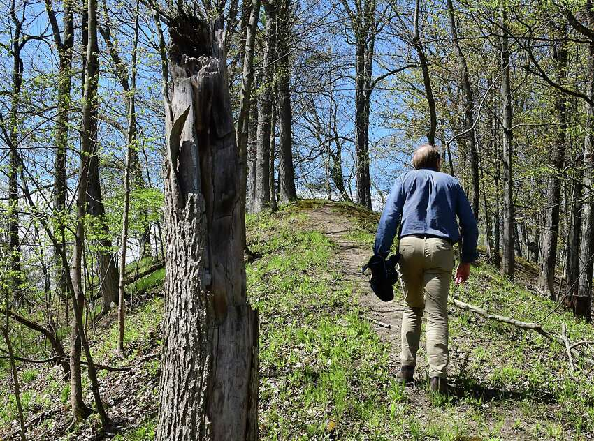 Town Supervisor David Van Luven is seen walking up a ridge in where the town is planning to create Normanskill Ravines, a new 147-acre park which was purchased from the Normanside Country Club on Thursday, May 14, 2020 in Bethlehem, N.Y. The park will include trails and includes some of the Normankill shore lines. (Lori Van Buren/Times Union)