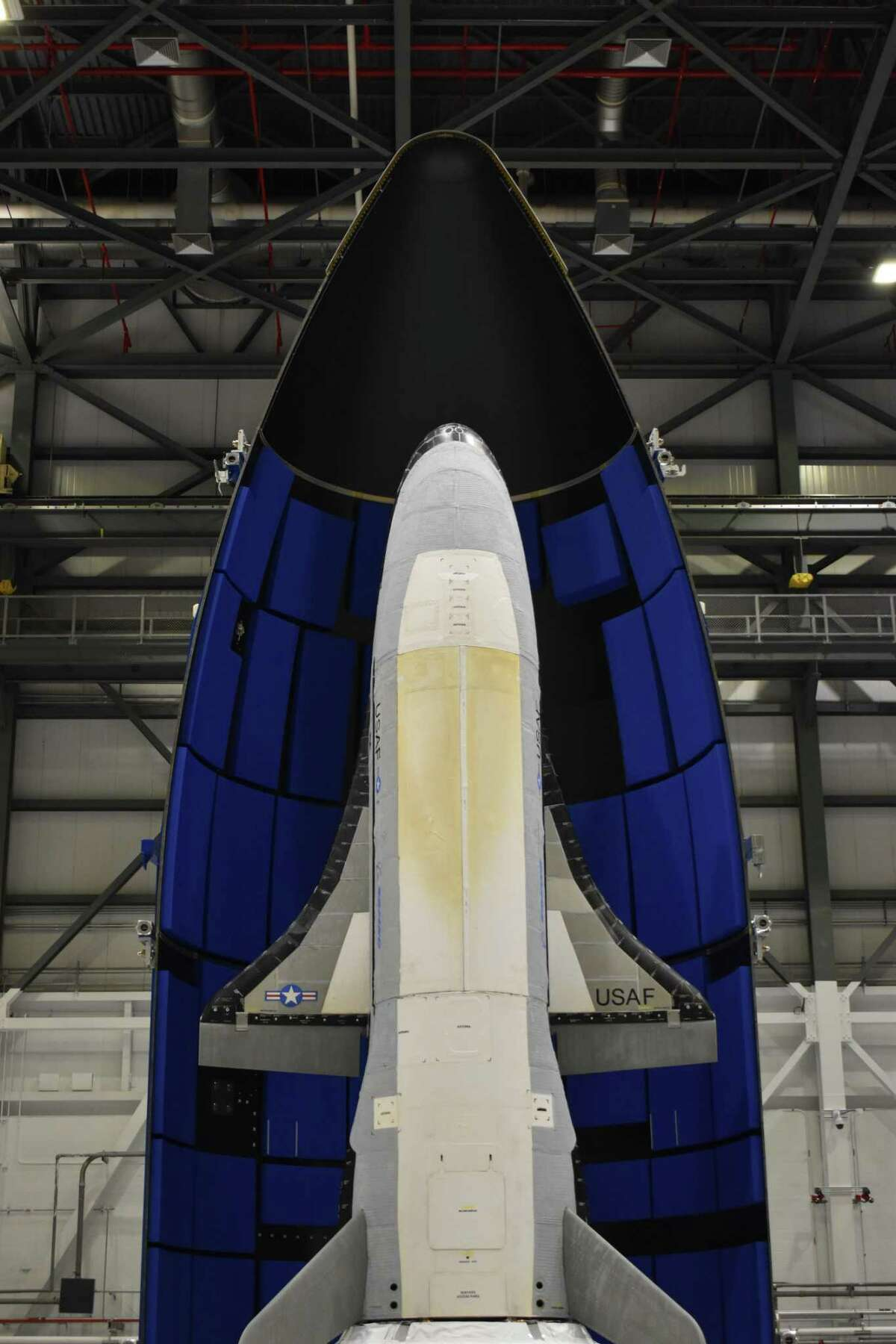 The encapsulated X-37B Orbital Test Vehicle for United States Space Force-7 mission. The vehicle is covered by a fairing during launch.