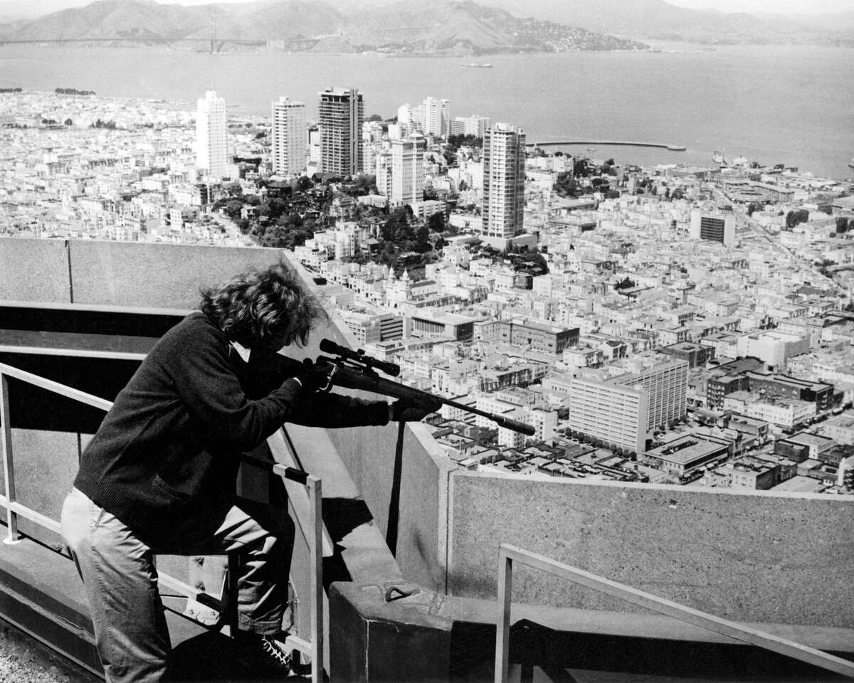 """After climbing down from his birds-eye view of the city, over the course of the next 100 minutes, our supposed hero, SFPD Inspector Callahan, will twist the broken leg of a helpless suspect, make a cowering bank robber gamble for his life, get his partner shot, and fail to save the life of a girl buried alive, all while snarling racial epithets at """"hoods"""" and """"spics.""""The film and its runaway success may have resonated for movie-goers living in San Francisco, who, at the time, were being terrified by a run of horrific, high-profile, violent crimes in real life.A string of up to 70 racially motivated murders by a small group of Black Muslim serial killers known as the """"Zebra"""" murders was causing widespread panic and headlines. Jim Jones was gathering his herd in the city, and would soon move the cult from their Geary Street headquarters to Guyana, where 918 people would succumb to their Kool-Aid induced deaths.An urban guerrilla group, the Symbionese Liberation Army, would soon kidnap 19-year-old Patty Hearst from her Berkeley apartment, before she infamously joined their ranks as """"Tania"""" and helped perpetuate their string of bank robberies and murder."""