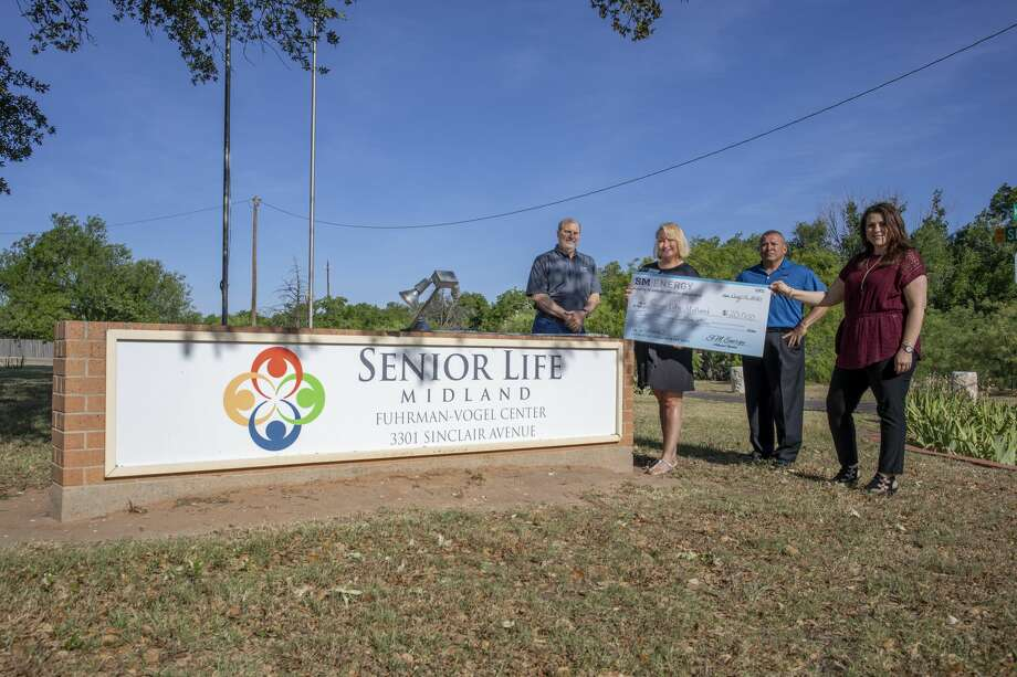 Senior Life Midland received a check for $20,000 from SM Energy on Thursday, May 14, 2020 outside of Senior Life offices. Pictured is Jeff Fulco, Kathleen Kirwan-Haynie, Gilbert Navarro and Tracy Renton. Jacy Lewis/Reporter-Telegram Photo: Jacy Lewis/Reporter-Telegram