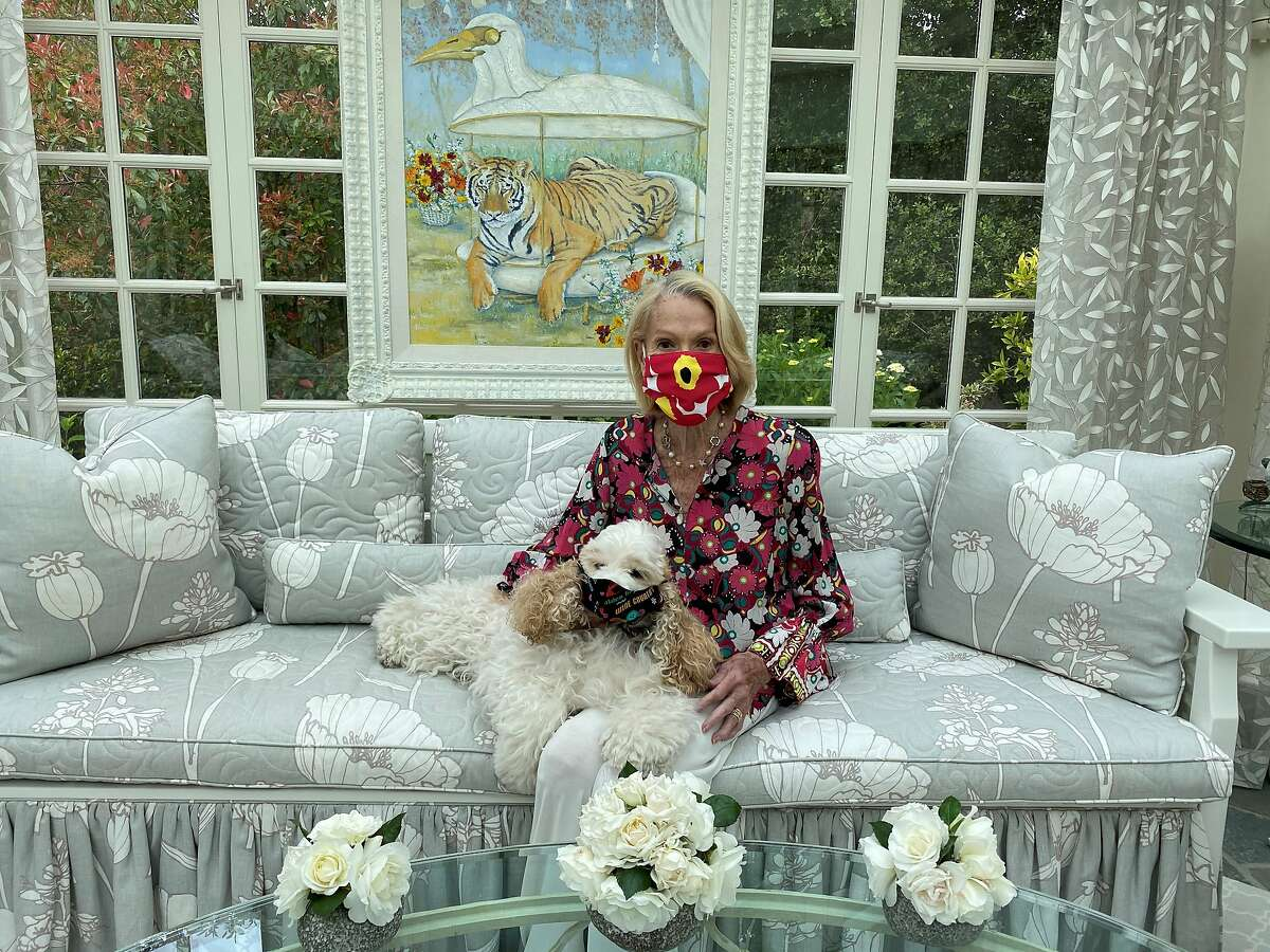 California and San Francisco protocol chief Charlotte Shultz at home with her dog, both wearing masks.
