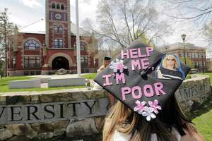 """A soon-to-graduate student, with a mortarboard cap adorned """"Help Me I'm Poor,"""" chats with friends while posing for photographs at the University of New Hampshire in Durham, N.H., on Friday. The pandemic has been a job killer. The U.S. now has an unemployment rate around 20 percent, which would be worse than all but the worst two years of the Great Depression."""