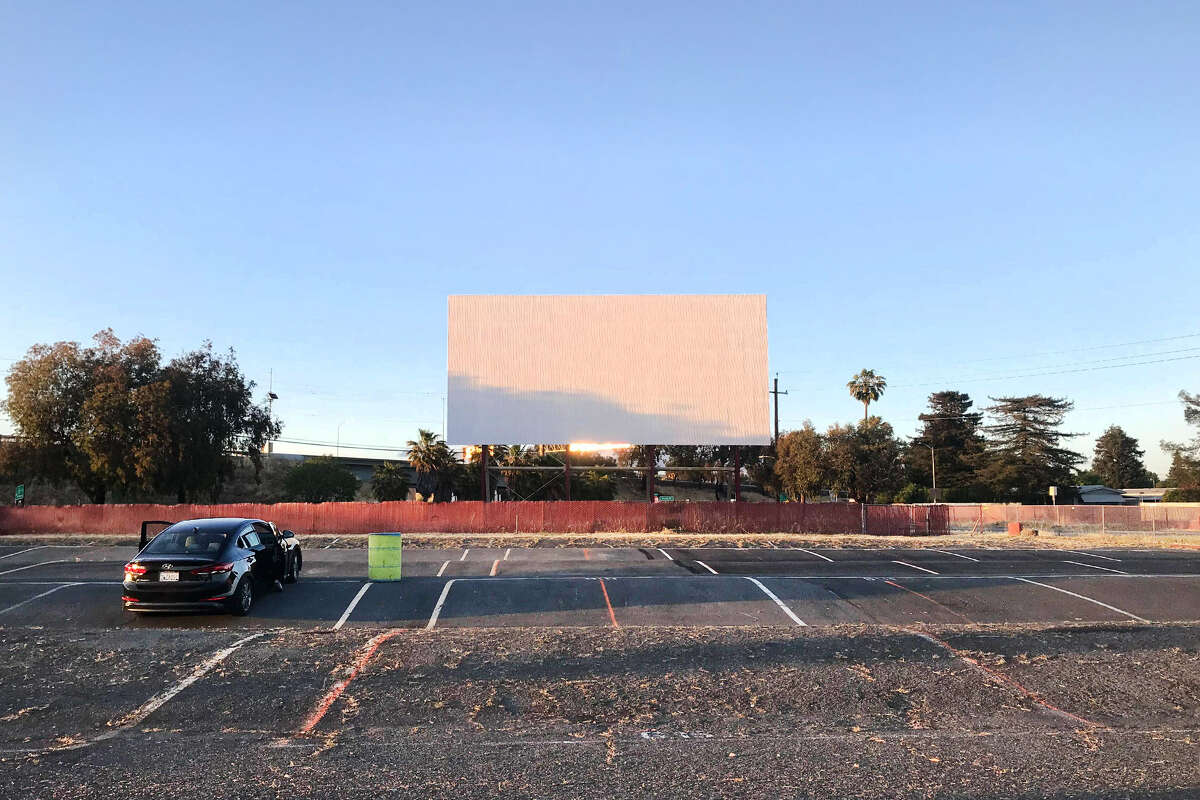 FILE - A new drive-in movie theater will take place at the Alameda County Fairgrounds. This is a photo of the West Wind Solano Drive-in Movie Theater in Concord, which recently closed as a result of the citywide curfew.