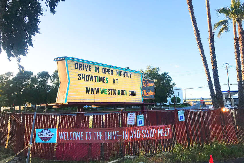 Nationwide, drive-in theaters are having an unexpected, anachronistic moment. Since their late-1950s heyday when 4,000 were in operation across the U.S., their numbers have been decimated. Now there are only about 300 left. But the state of California allowed the few drive-in movies left to reopen in early May, despite the ongoing lockdown. The Bay Area has two of them - this West Wind Solano location in Concord and its sister venue in San Jose - and both have to operate under strict guidelines. Visitors must stay in their cars unless they need to use the restroom, over by the shuttered snack counter between the two screens. Only a few people can be in the restroom (wearing cloth masks) at a given time, and vehicles must be parked 10 feet apart. To ensure that last rule, employees painted throughout the expansive pavement to guide guests to find a spot.
