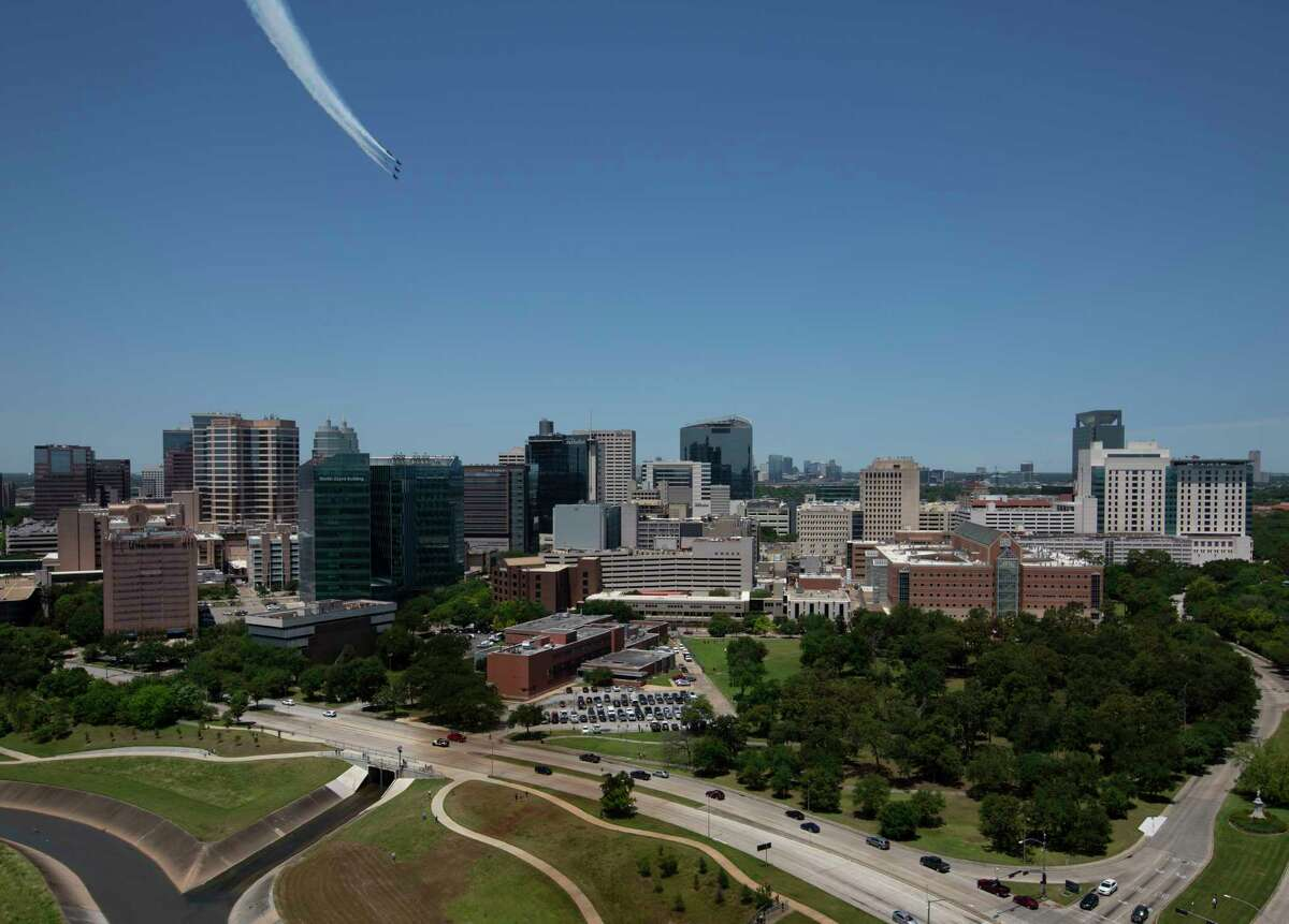 The Blue Angels fly over the Texas Medical Center Wednesday, May 6, 2020, from Vantage Med Center in Houston.