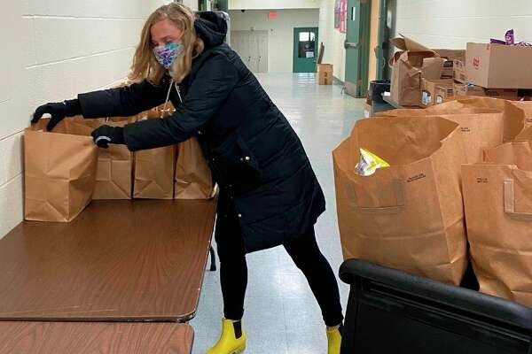 Bear Lake Schools principal Sarah Harless loads bags of food to be delivered to students under the lunch program. Harless was nominated by a member of the community as Hero Unmasked for her efforts helping others with the food program during the COVID-19 pandemic. (Courtesy photo)