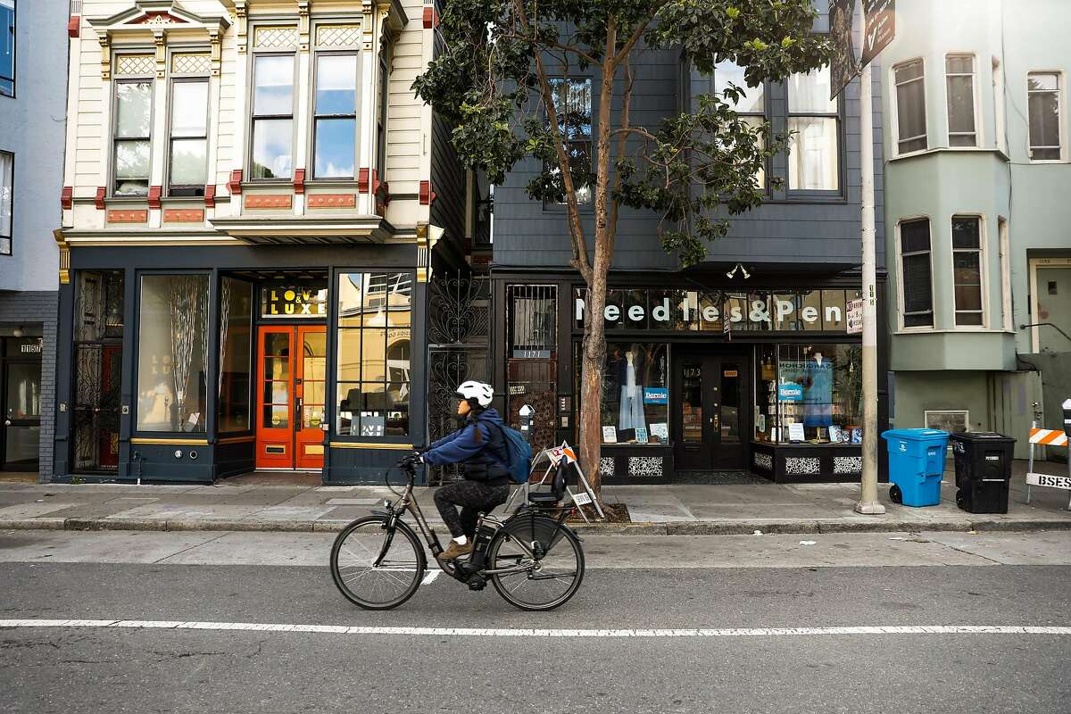 Stores are closed on Valencia Street during the citywide lockdown due to the coronavirus on Tuesday, March 17, 2020 in San Francisco, California.