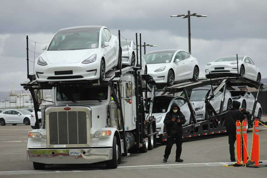 A truck hauling Tesla autos out of the company's factory in Fremont, Calif., on Tuesday, May 12, 2020. Elon Musk opened his California factory this week in defiance of local orders. (Jim Wilson/The New York Times)