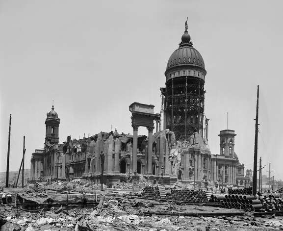 "By 1900, City Hall was finally fully open for business, but it only took six years for it all to come tumbling down. On the morning of April 18, 1906, the devastasting earthquake hit. An Examiner reporter near City Hall later recalled seeing the building undulating like it was being rolled along the ocean waves. ""Tons upon tons upon tons of that mighty pile slid away from the steel framework,"" he wrote. In 20 seconds, City Hall was destroyed. From Larkin to Leavenworth, the building was rubble. Photo: Universal History Archive/Universal Images Group Via Getty"