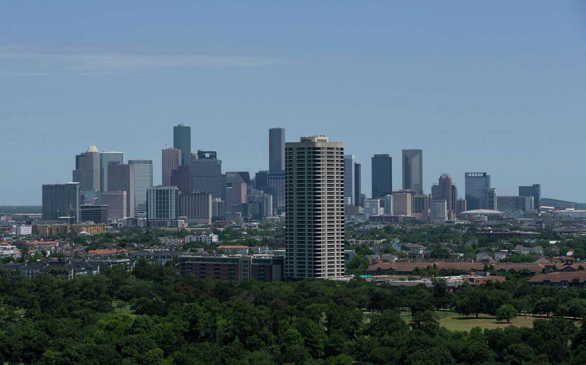 Downtown Houston with the Parklane Condo Tower Wednesday, May 6, 2020, in Houston.