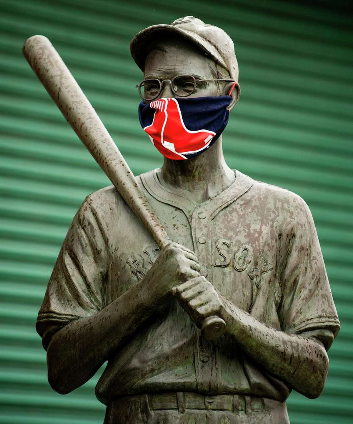 Even Dom DiMaggio - or at least, his statue outside Fenway Park in Boston - is wearing a mask.