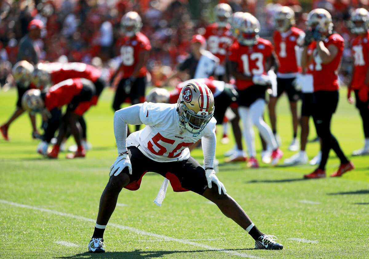 San Francisco 49ers linebacker LaRoy Reynolds (50) stretches during football training camp at Levi's Stadium practice field in Santa Clara, Calif., on Saturday, July 27, 2019.