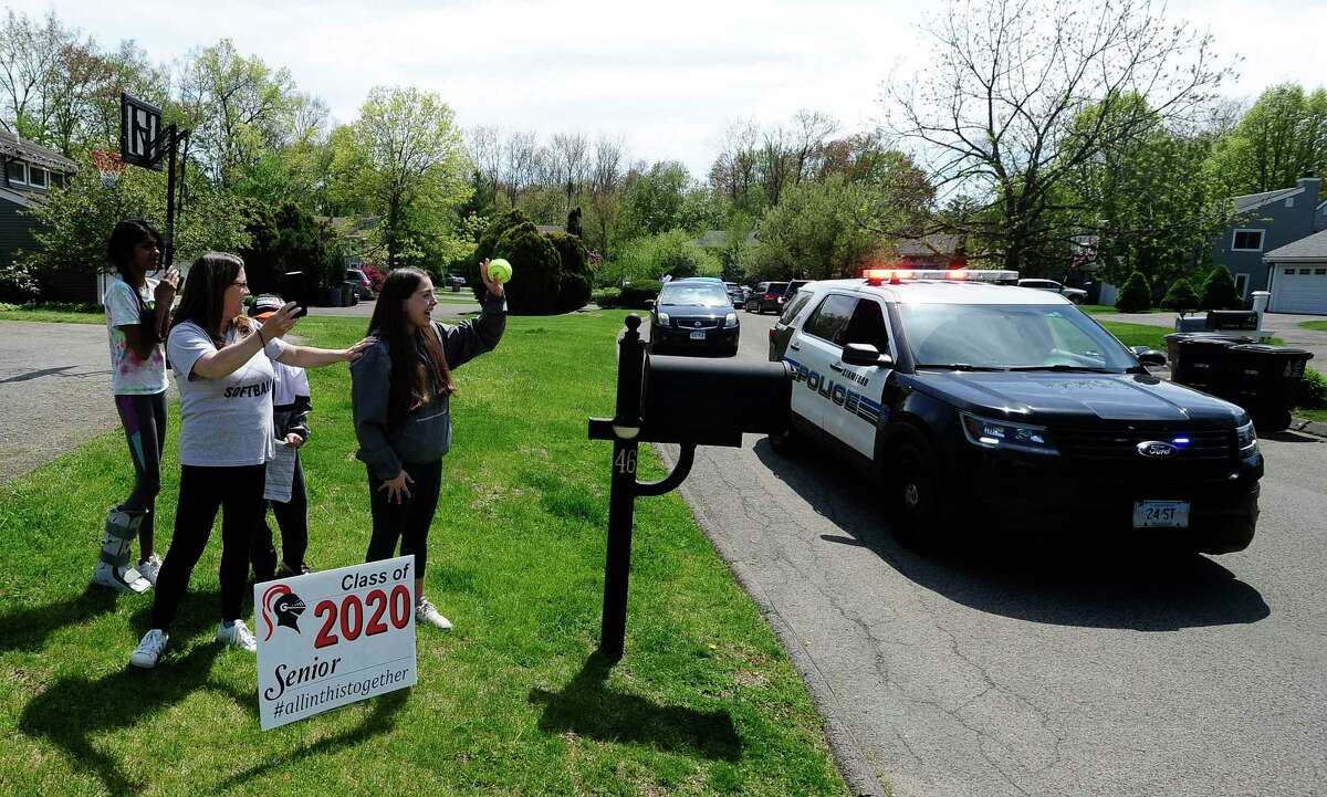 A caravan of players, former teammates and friends parade pass the homes of Stamford High School's Class of 2020 senior softball players Emily Ferretti and Morgan Yacavone, led by their coach Melissa Giordano, Thursday, May 14, 2020 in Stamford, Connecticut. With the Lady Black Knights season cancel, due to school closings in response to the Covid-19 Pandemic, Giordano wanted to recognize her two seniors and their accomplishments. Emotions and excitement ran high with both players crying with joy, receiving cards, a signed ball and a lot of virtual hugs, as the players and friend practice responsible social distancing. Stamford Police provided an escort, so that participants could safely travel from one players home to the other, provide an occasional blast from the sirens.