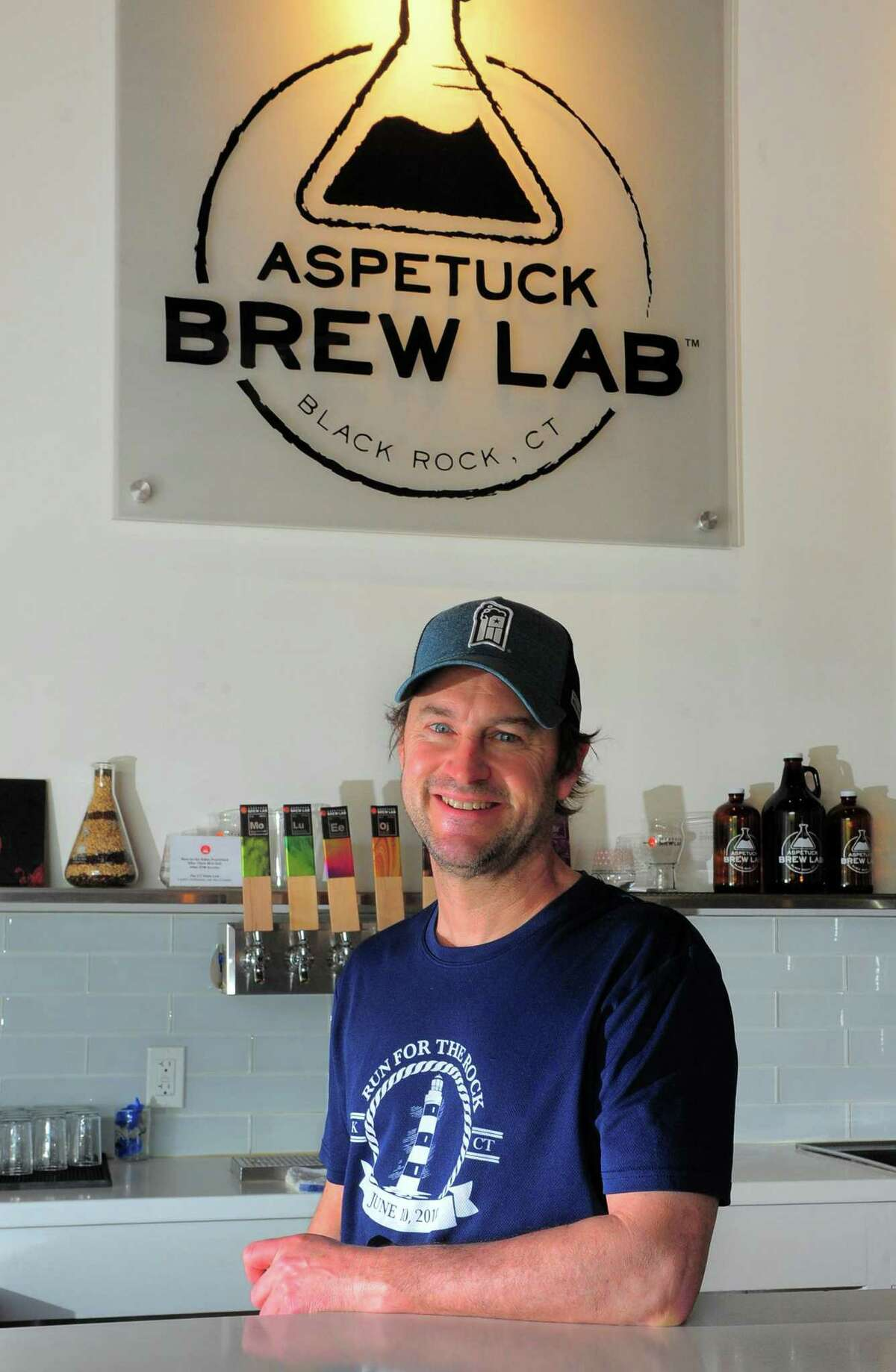 Aspetuck Brew Lab co-owner Peter Cowles poses at the brewery in Bridgeport, Conn., on Thursday May 14, 2020. Cowles was one of a handful of Bridgeport business leaders and business owners statewide who recently signed a letter urging Gov. Lamont move more quickly to reopen restaurants.