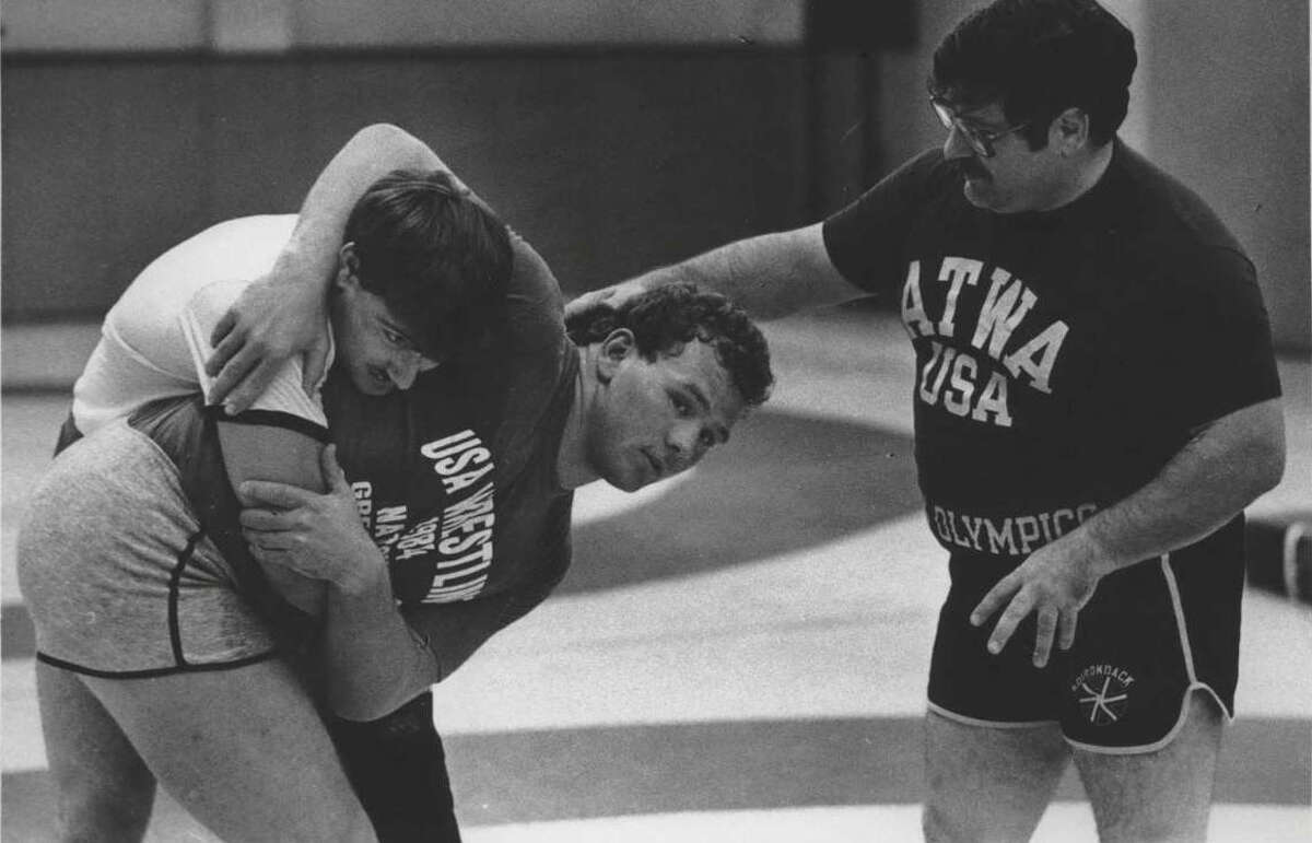 Wrestlers practice at State University of New York, Albany - Chris Tironi Undated (dark shirt), Matthew Ryan, and Joe DeMeo. September 26, Undated (Hai Do/Times Union Archive)