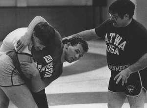 Wrestlers practice at State University of New York, Albany - Chris Tironi Undated (dark shirt), Matthew Ryan, and Joe DeMeo. September 26, Undated (Hai Do/Times Union Archive)