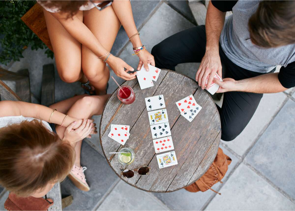 Poker With several variations, poker is a highly popular card game played recreationally, competitively, and professionally (in-person and online). Usually played for money or some substitute, poker involves players wagering over whether or not their hand is better than those of the other players. Players can