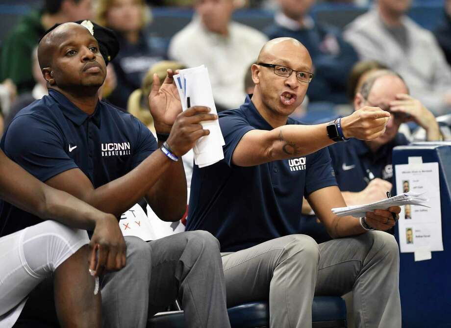 Former UConn associate head coach Raphael Chillious, right, and assistant coach Dwayne Killings during an Oct. 17 game in Hartford. Photo: Jessica Hill / Associated Press / AP2017
