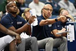 Former UConn associate head coach Raphael Chillious, right, and assistant coach Dwayne Killings during an Oct. 17 game in Hartford.