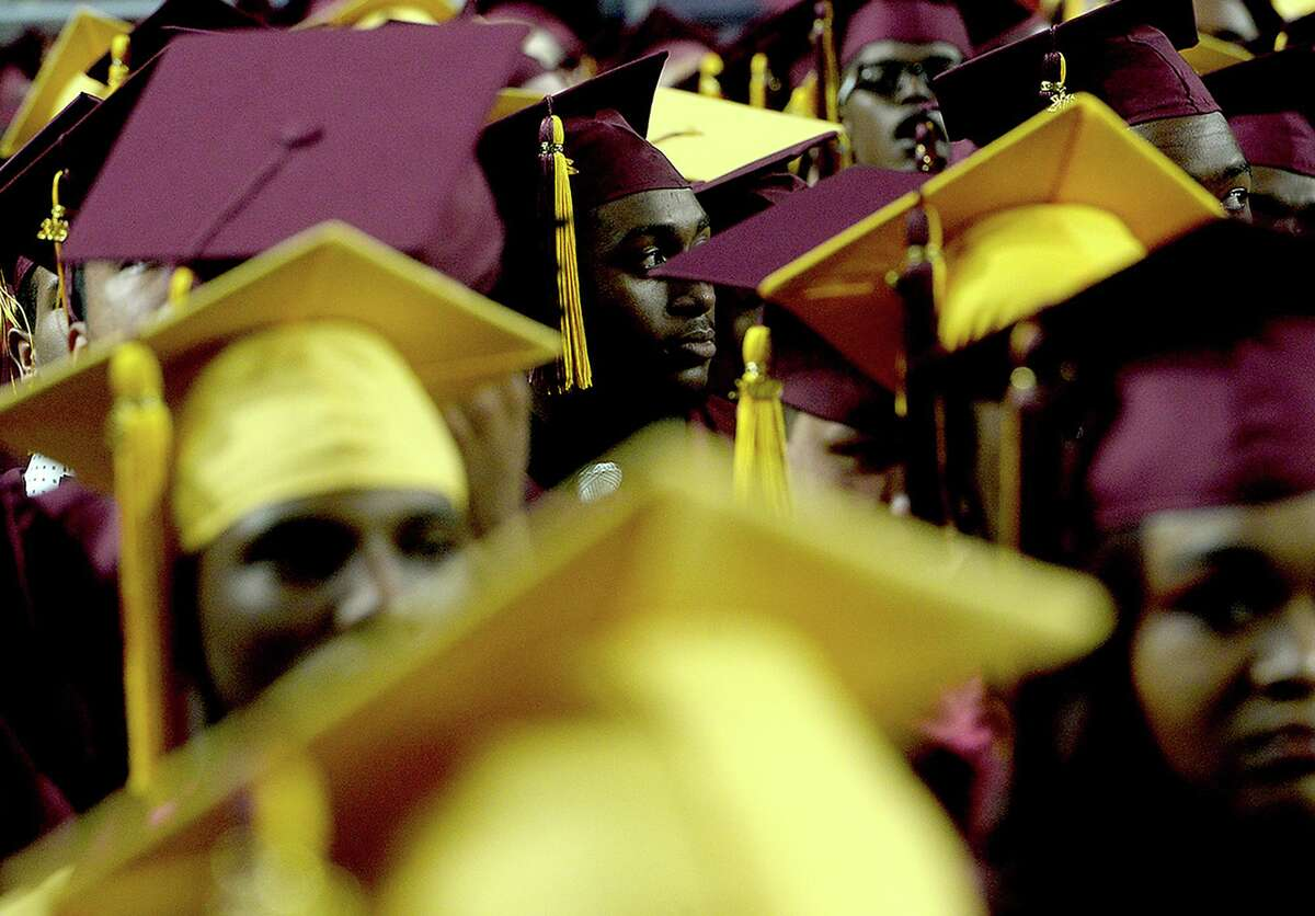Graduates observe the diploma awards as they await their turn onstage during Beaumont United's first commencement ceremony Friday at the Montagne Center. Photo taken Friday, May 24, 2019 Kim Brent/The Enterprise
