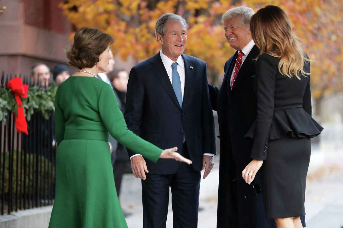 Former first lady Laura Bush and former President George W. Bush greet President Donald Trump and first lady Melania Trump outside of Blair House Dec. 4, 2018 in Washington, D.C. The Trumps were paying a condolence visit to the Bush family, who were in Washington for former President George H.W. Bush's state funeral and related honors. (Chip Somodevilla/Pool/Abaca Press/TNS)