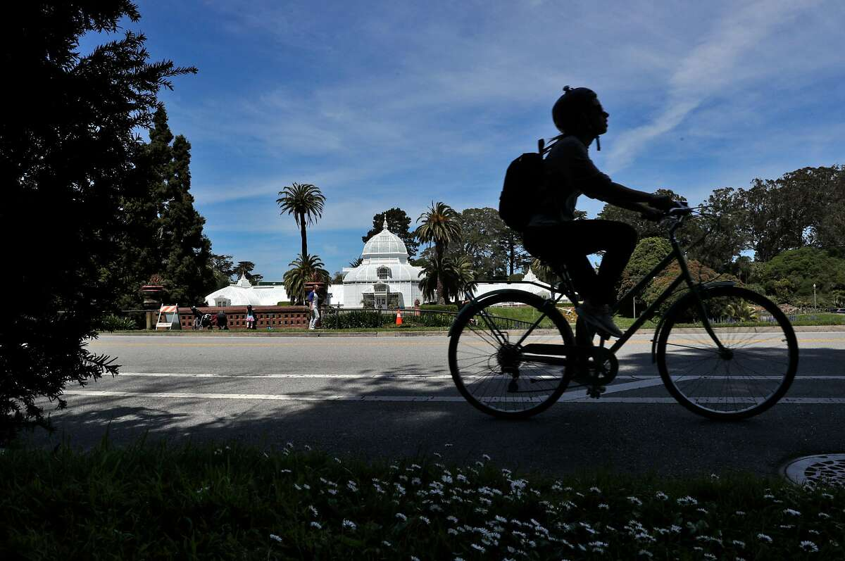 A bicyclist rides on John F. Kennedy Drive in Golden Gate Park in San Francisco, Calif., on Monday, April 27, 2020. City health officials extended the stay at home order until the end of May, and will be shutting down the street to vehicle traffic.