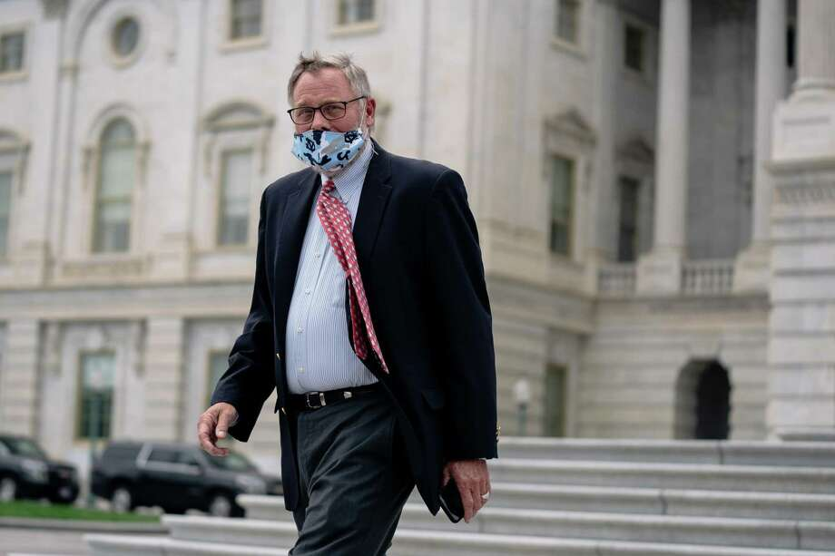 Sen. Richard Burr (R-N.C.) departs the Capitol after a vote in Washington, Thursday, May 14, 2020. Burr temporarily stepped down as chairman of the Senate Intelligence Committee on May 14, a day after FBI agents seized his cellphone amid an investigation into whether he sold hundreds of thousands of dollars' worth of stocks using nonpublic information about the coronavirus. (Anna Moneymaker/The New York Times) Photo: ANNA MONEYMAKER, STF / NYT / NYTNS