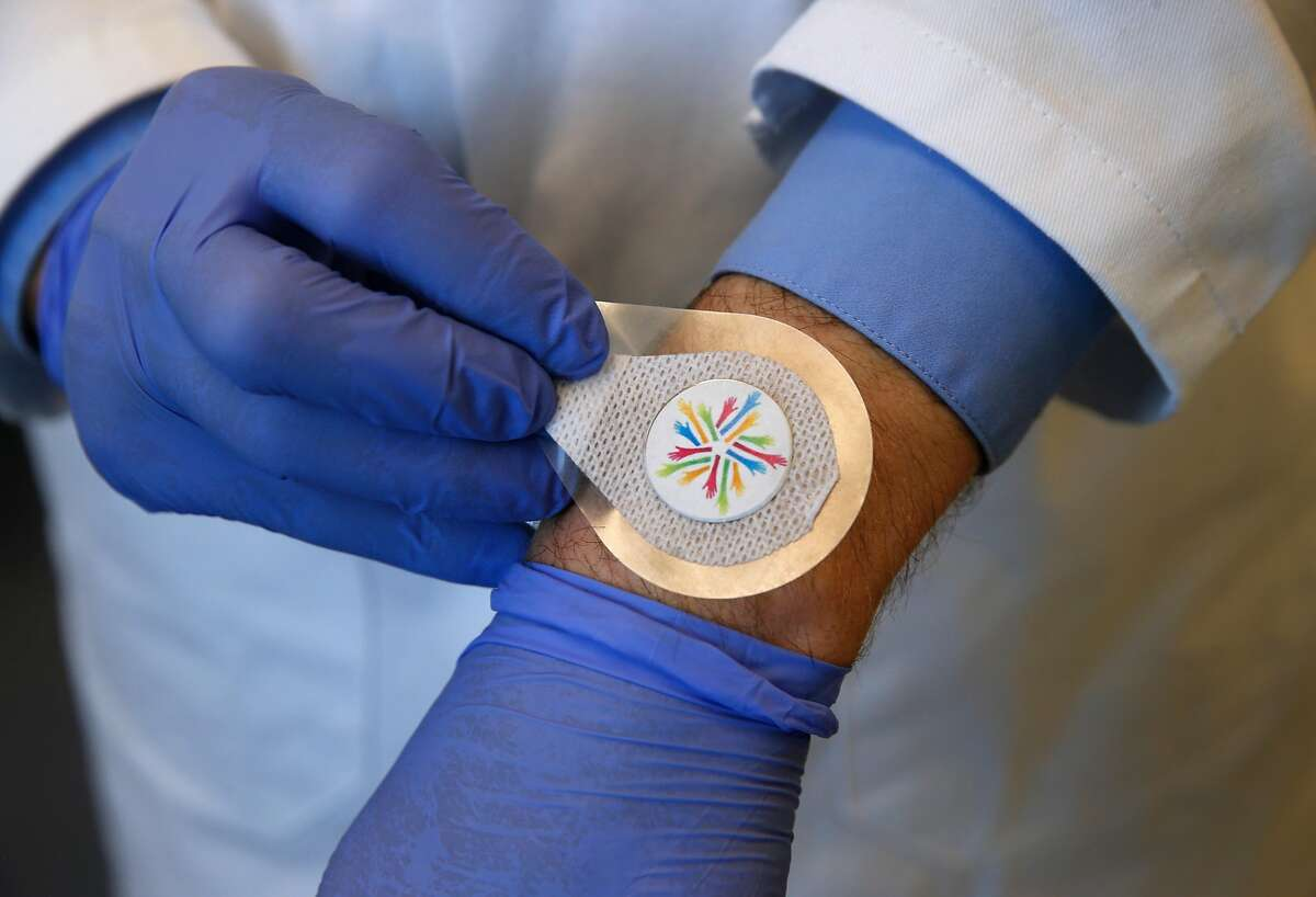Thomas Ellison tests a vaccine patch under development in a Verndari biotech lab at the UC Davis Medical Center in Sacramento, Calif. on Thursday, May 7, 2020. Verndari is racing to develop a COVID-19 coronavirus vaccine administered through a patch worn on the skin.