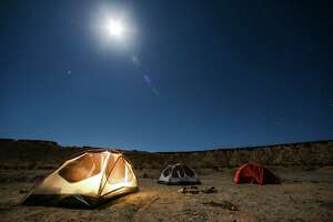 The full moon rises above tents at a campsite outside Big Bend National Park Saturday, April 8, 2017 in Terlingua. ( Michael Ciaglo / Houston Chronicle)