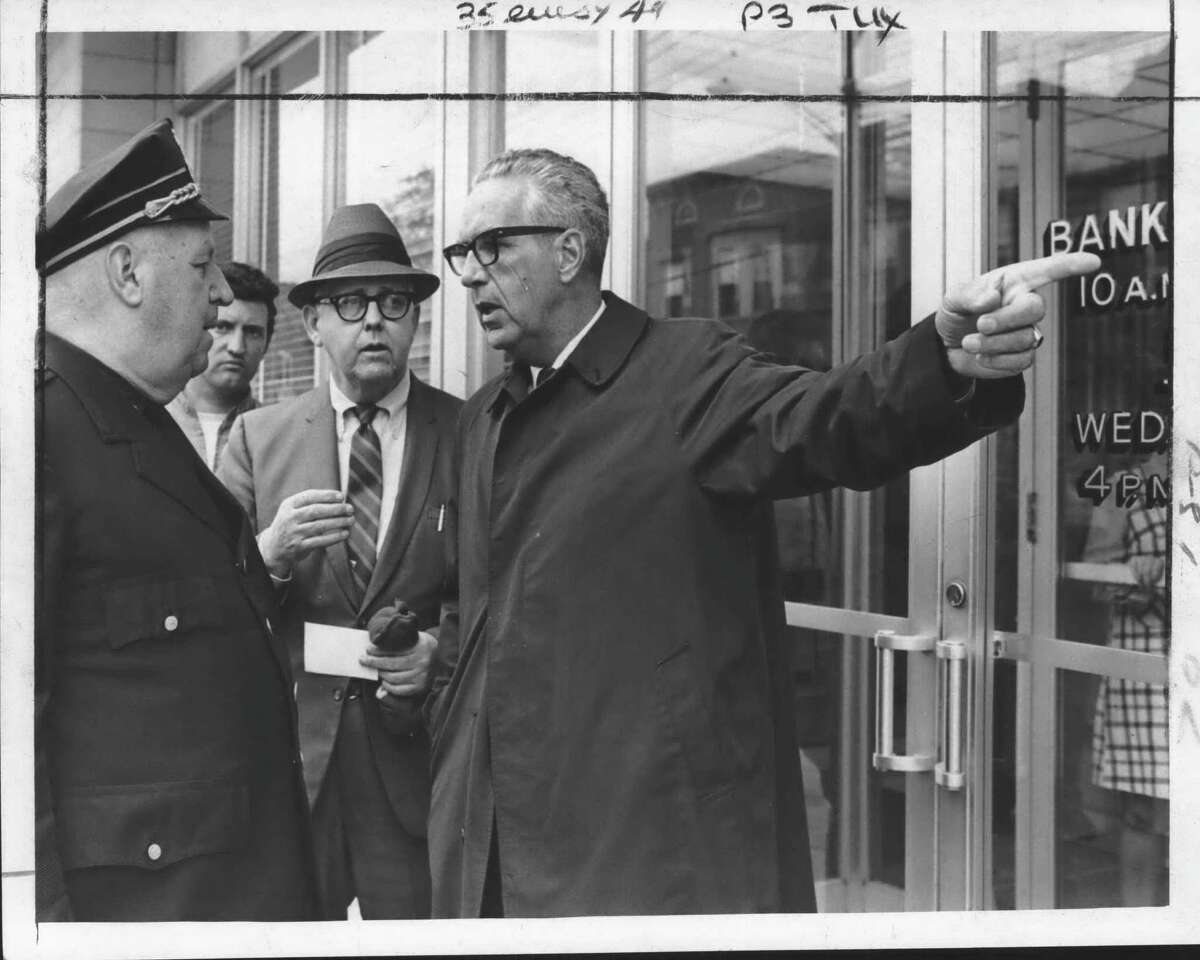 Capt. Herbert Devlin, Inspector Charles Mahar and Police Chief Edward McArdle manage the scene at the attempted robbery of a State Bank of Albany branch on New Scotland Avenue on May 14, 1970 (Joe Higgins/Times Union Archive)
