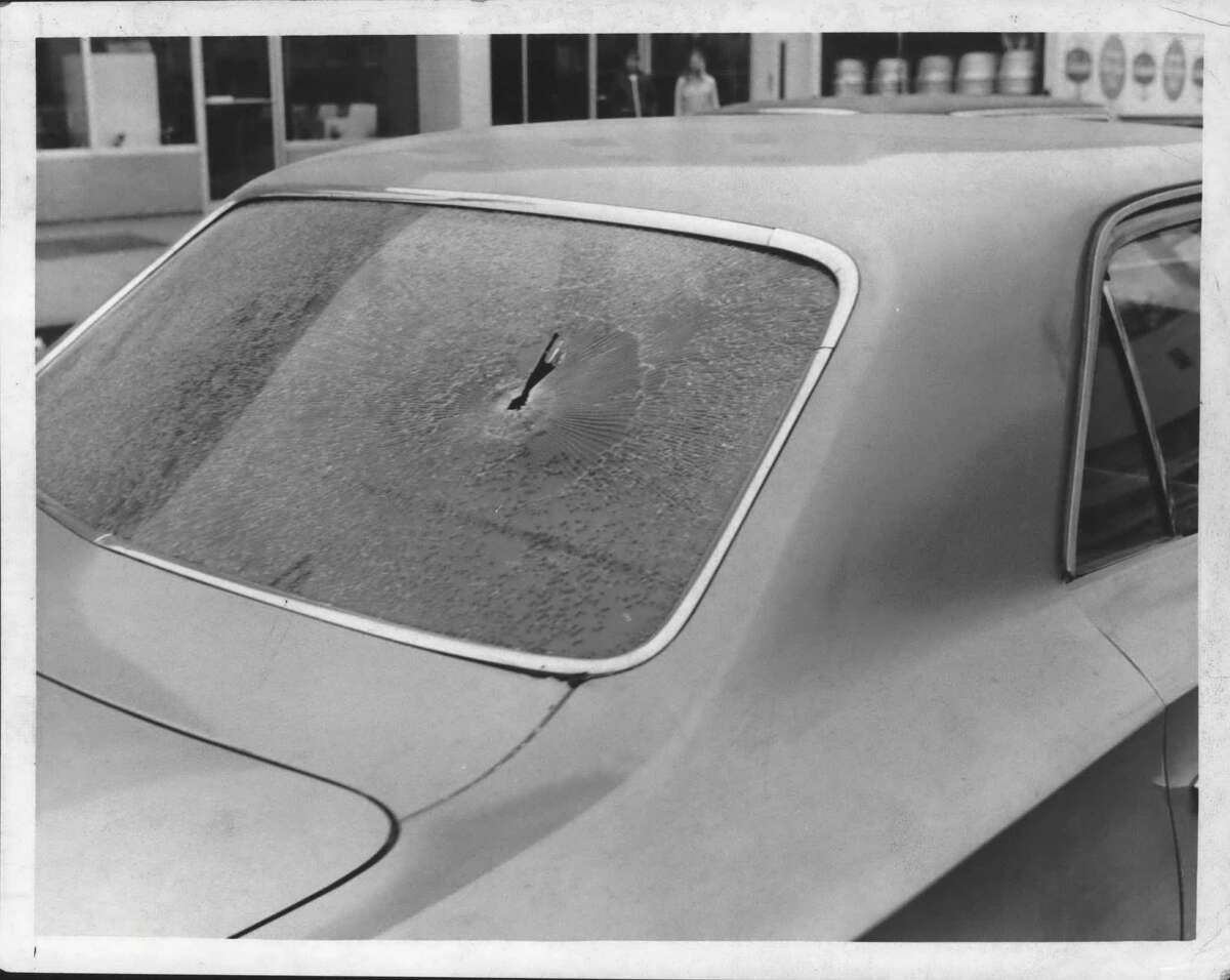 A bullet hole pierced the rear window of an Albany detective's car at State Bank of Albany, New Scotland Avenue branch, where an attempted robbery occurred on May 14, 1970. The front window was also riddled. (Joe Higgins/Times Union Archive)