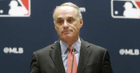 In this Nov. 21, 2019, file photo, baseball commissioner Rob Manfred speaks to the media at the owners meeting in Arlington, Texas. (AP Photo/LM Otero, File)