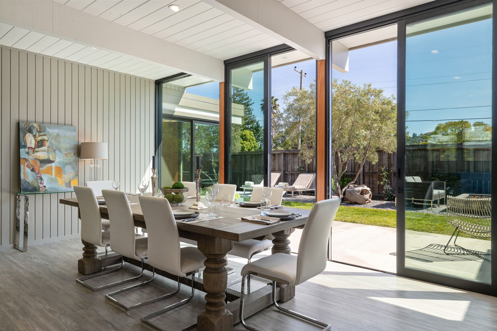 The dining area is an entertaining space newly added to the home, but it fits seamlessly with the original portion and leads out to the large backyard.
